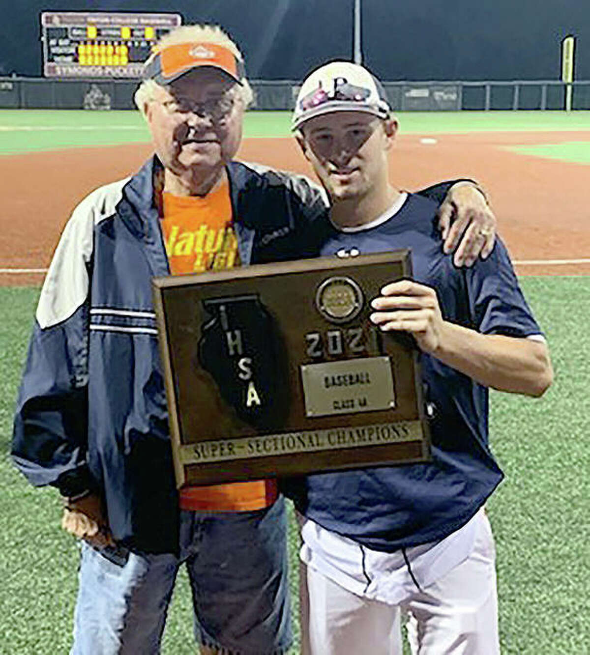 Wood River's Don Cobb, left, and his grandson, Lake Park High School sophomore catcher Danny Rollins following the IHSA Class 4A state baseball championship game last week in Joliet. Rollins' team finished second in the state, just like his grandfather's East Alton-Wood River High School team did 60 years ago.