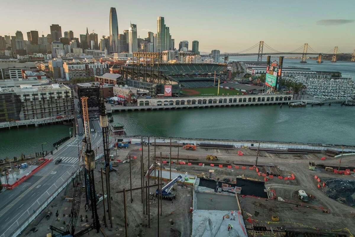 Construction crews pour concrete in a section of the new Mission Rock development near Oracle Park. The development, a collaboration between the San Francisco Giants, Tishman Speyer and the Port of San Francisco is building with the impending sea level rise in mind and elevating the ground level.