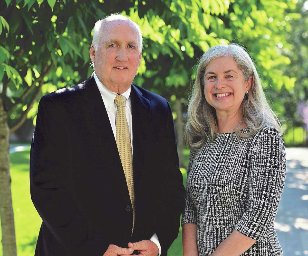 Democratic first selectman candidate Bill Kelly, left, with selectman candidate Janet Stone McGuigan.