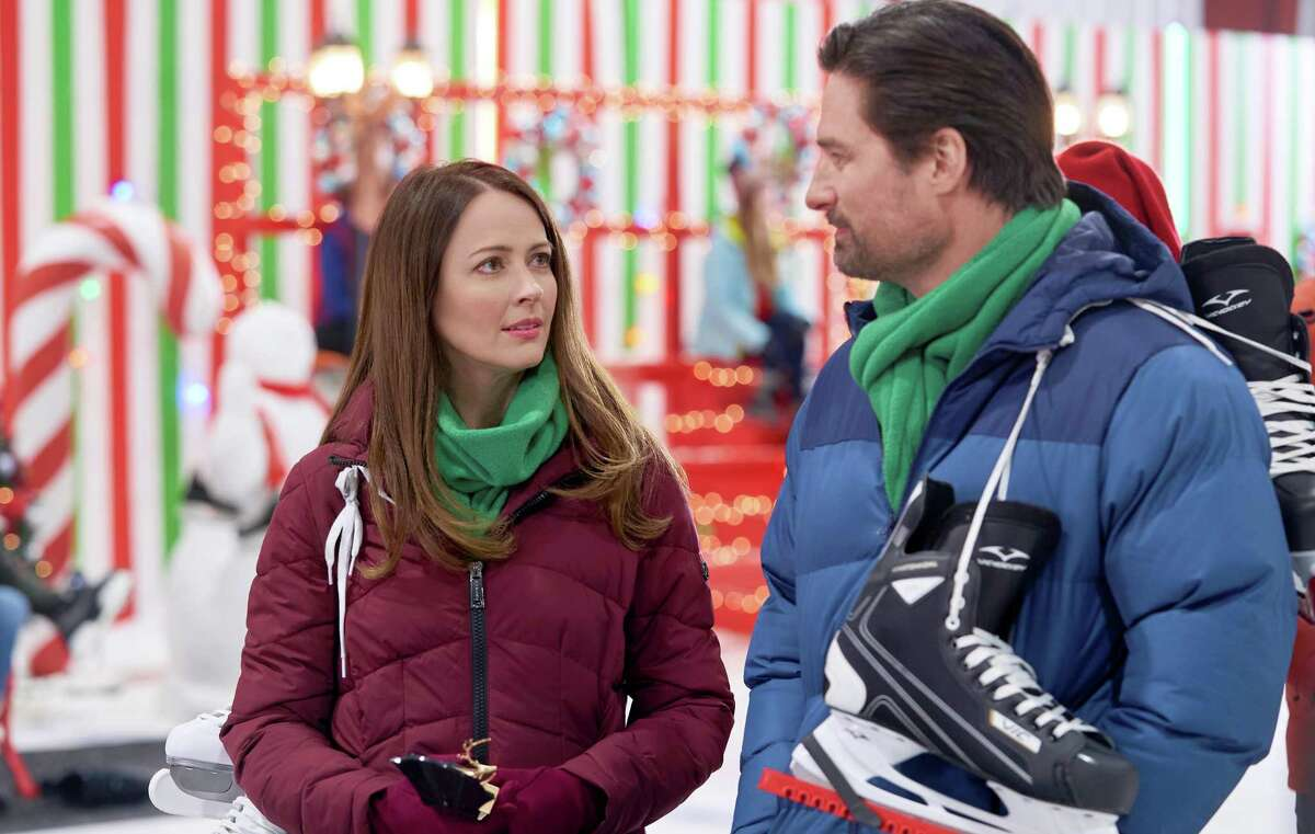 """A strong attraction soon builds between divorced mom Maggie and surprise visitor Sam (Warren Christie) in Christmas in July's """"Crashing Through the Snow."""""""