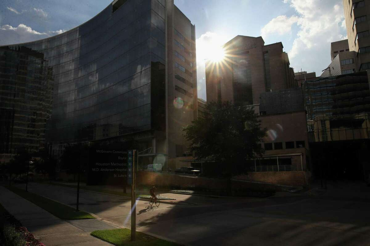 A cyclist rides along Bertner Avenue near Houston Methodist Hospital on Tuesday, June 22, 2021, in the Texas Medical Center in Houston.
