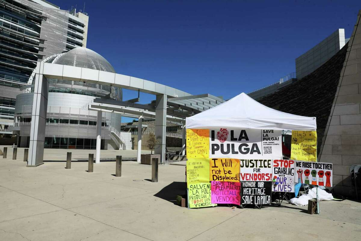 Members of The Berryessa Flea Market Vendor Association, who went on a hunger strike Monday to protest a development plan that could displace hundreds of vendors, are resting under a canopy during their solidarity protest at San Jose City Hall on Tuesday, June 22, 2021, in San Jose, Calif.