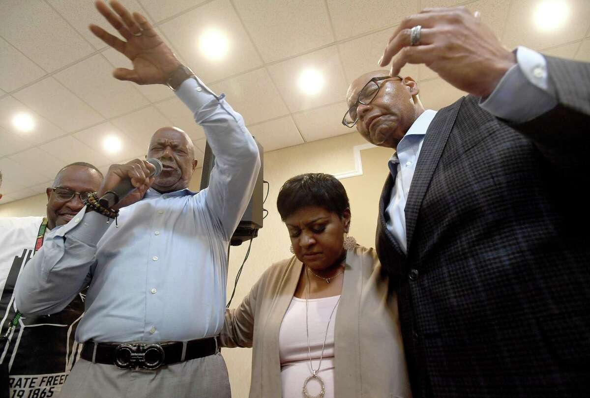 Robin Mouton is flanked by pastors Edison Colbert and John Adolph as they prray and celebrate hher victory at her watch party in Beaumont's mayoral run-off election Saturday. Photo made Saturday, June 19, 2021 Kim Brent/The Enterprise