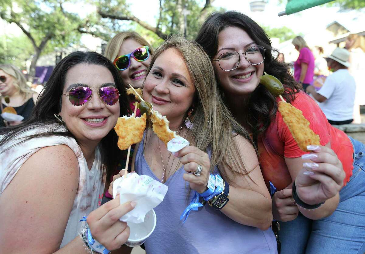 Sarah Lewis, from right, Diane Rivera, Roxanne Cervantes Pino and Clarissa Gonzalez enjoy their chicken on a stick during the first night of NIOSA at La Villita.