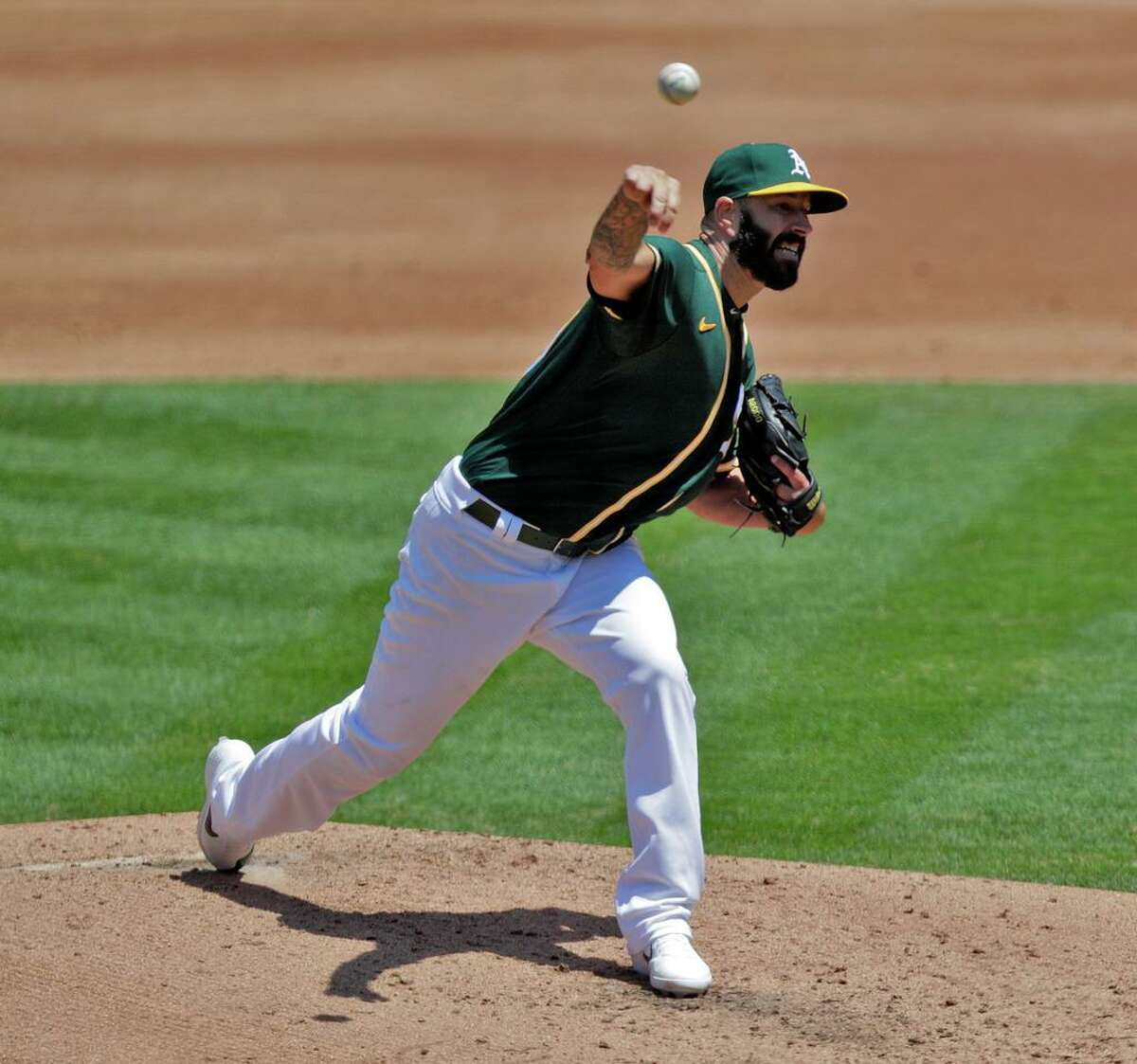 A's starter Mike Fiers (50) pitches in the first inning as the Oakland Athletics played the Los Angeles Angels of Anaheim at the Coliseum in Oakland, Calif., on Sunday, July 26, 2020.