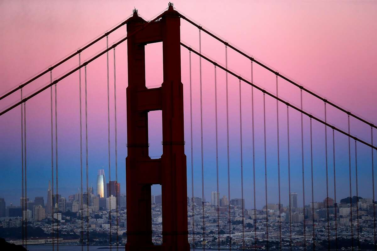 The Salesforce Tower and the San Francisco skyline behind the Golden Gate Bridge at dusk on Sunday, July 14, 2019.