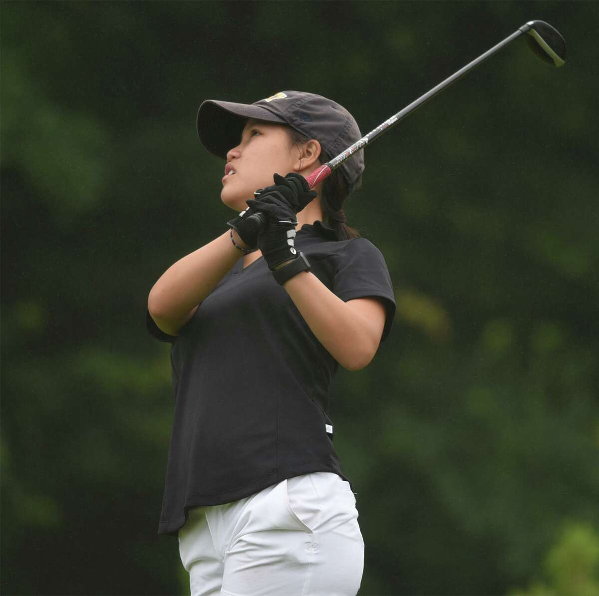 New Canaan senior co-captain Julia Bazata tees off on the 12th hole during the FCIAC girls golf championship at Fairchild Wheeler Golf Course on Thursday, June 3, 2021.