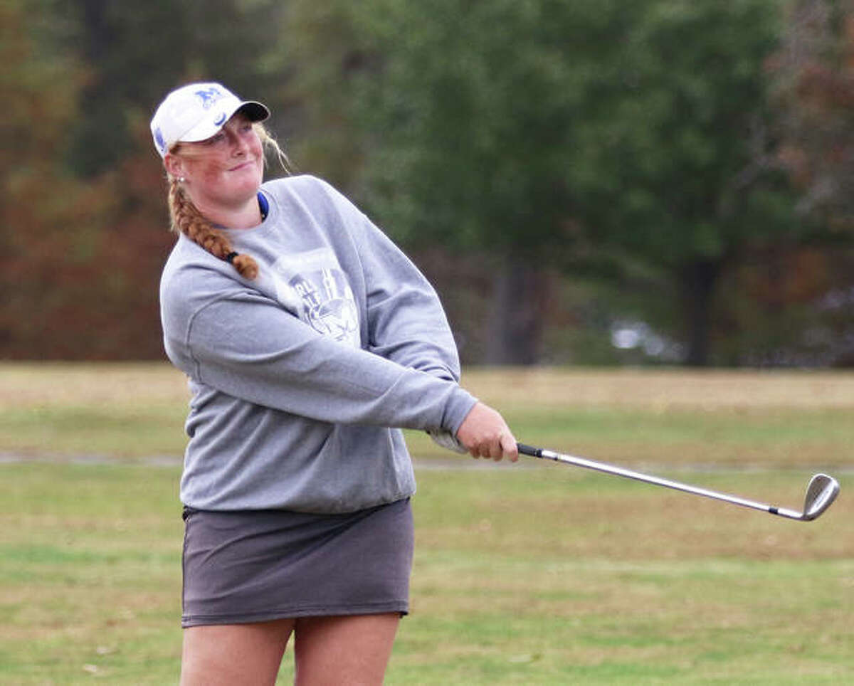 Marquette Catholic senior Gracie Piar, shown watching her shot during a Class 1A sectional as a junior last season, advanced to the semifinals of the 87th Illinois Women's Amateur Golf Championship last week at Pine Meadow Golf Club in Mundelein.