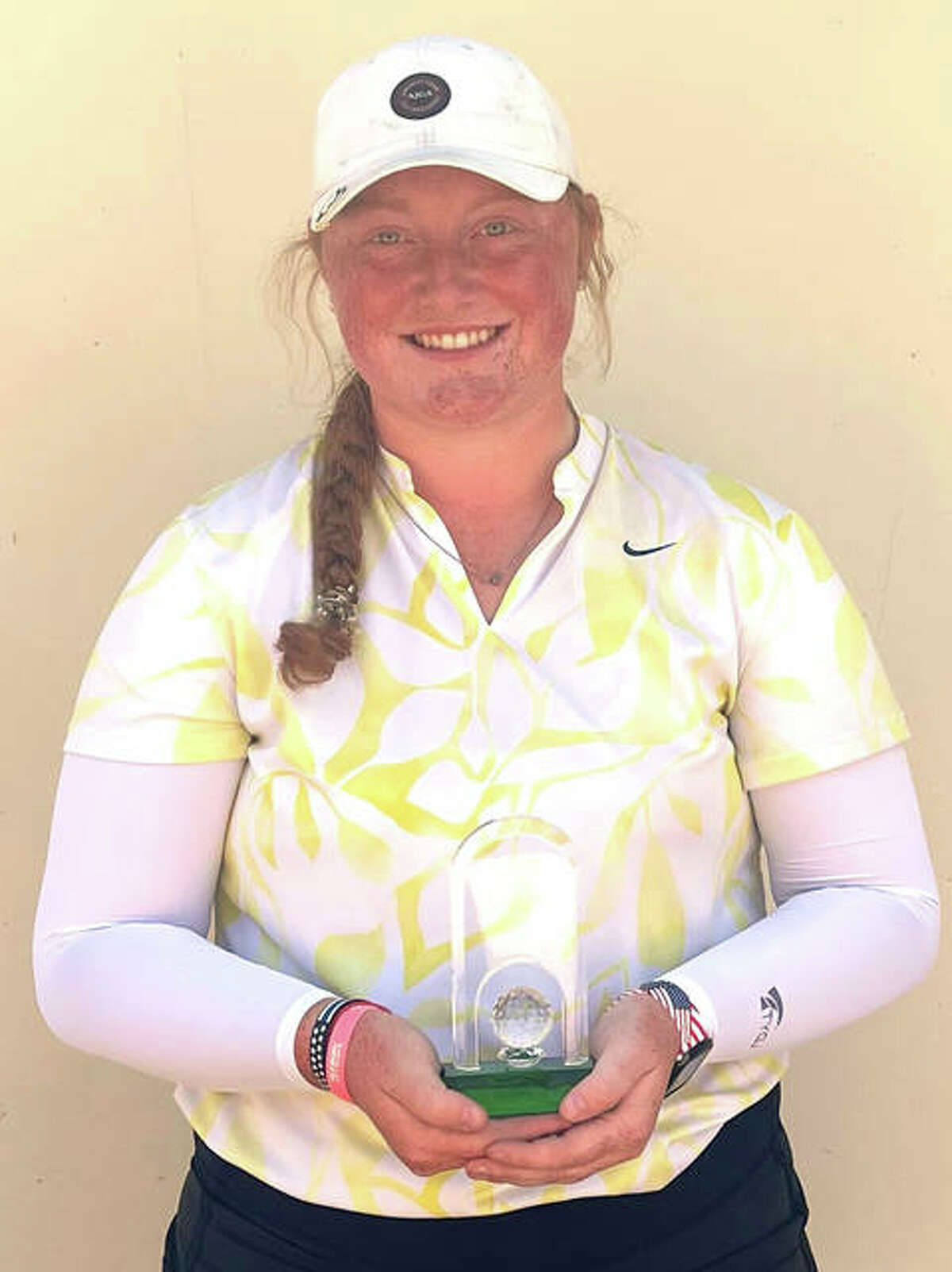East Alton's Gracie Piar with her semifinalist trophy Thursday at the Illinois Women's Amateur Golf Championship in Mundelein.