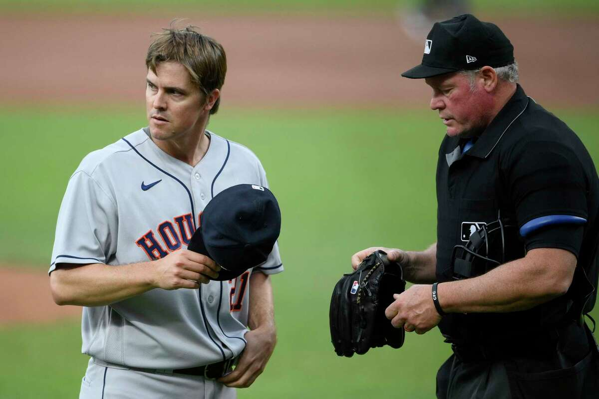 Astros pitcher Zack Greinke, having his glove inspected Tuesday by home plate umpire Ted Barrett in Baltimore, and his teammates have remained relatively tame under the circumstances compared to other hurlers around the majors.