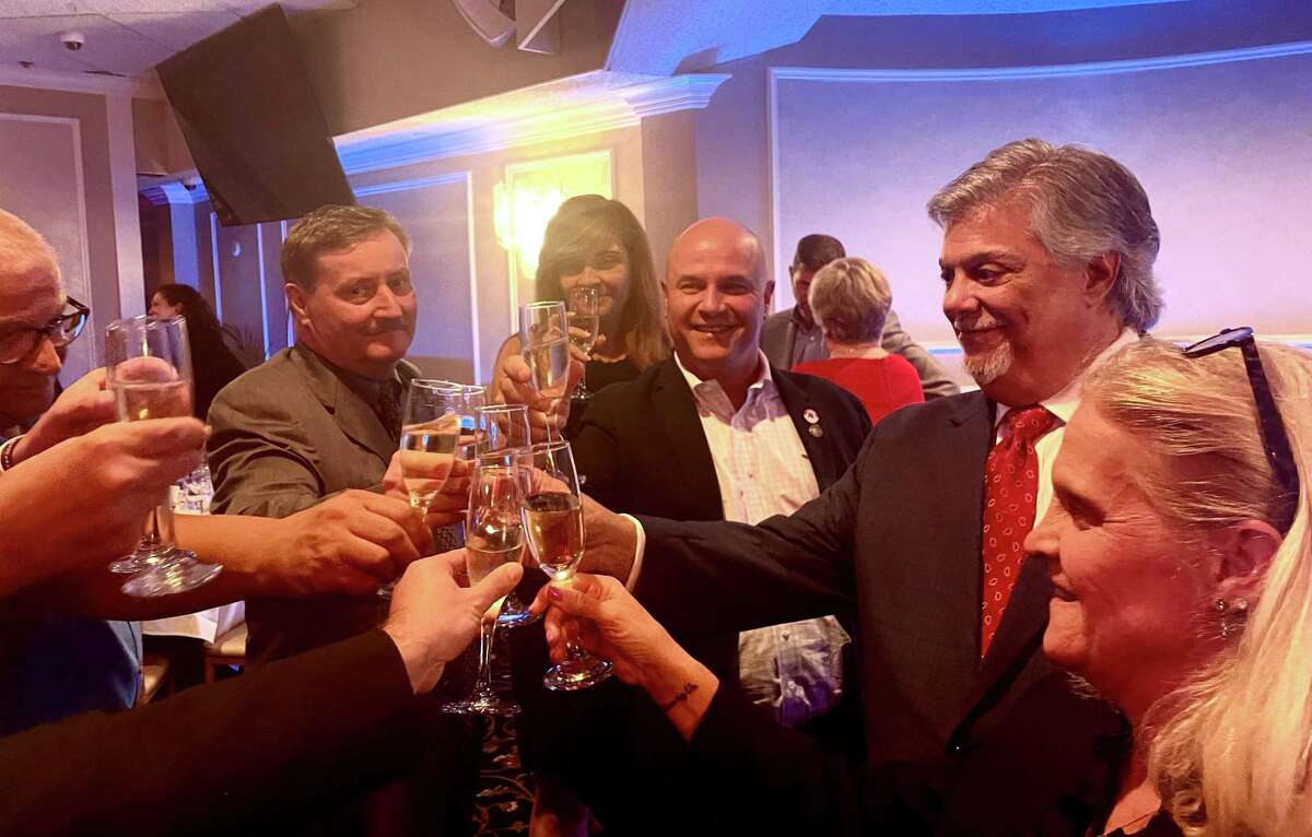 Longtime GOP operative Ben Proto, a lawyer from Stratford, second from right, was elected chairman of the state Republican party Tuesday night.