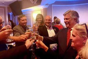 Longtime GOP operative Ben Proto, a lawyer from Stratford, second from right, was nominated for chair of the state Republican party Tuesday night.