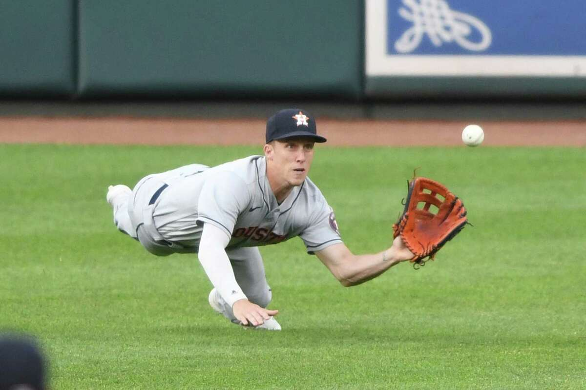 Astros center fielder Myles Straw makes a diving catch on a Cedric Mullins fly ball during the third inning of Tuesday's win at Baltimore.