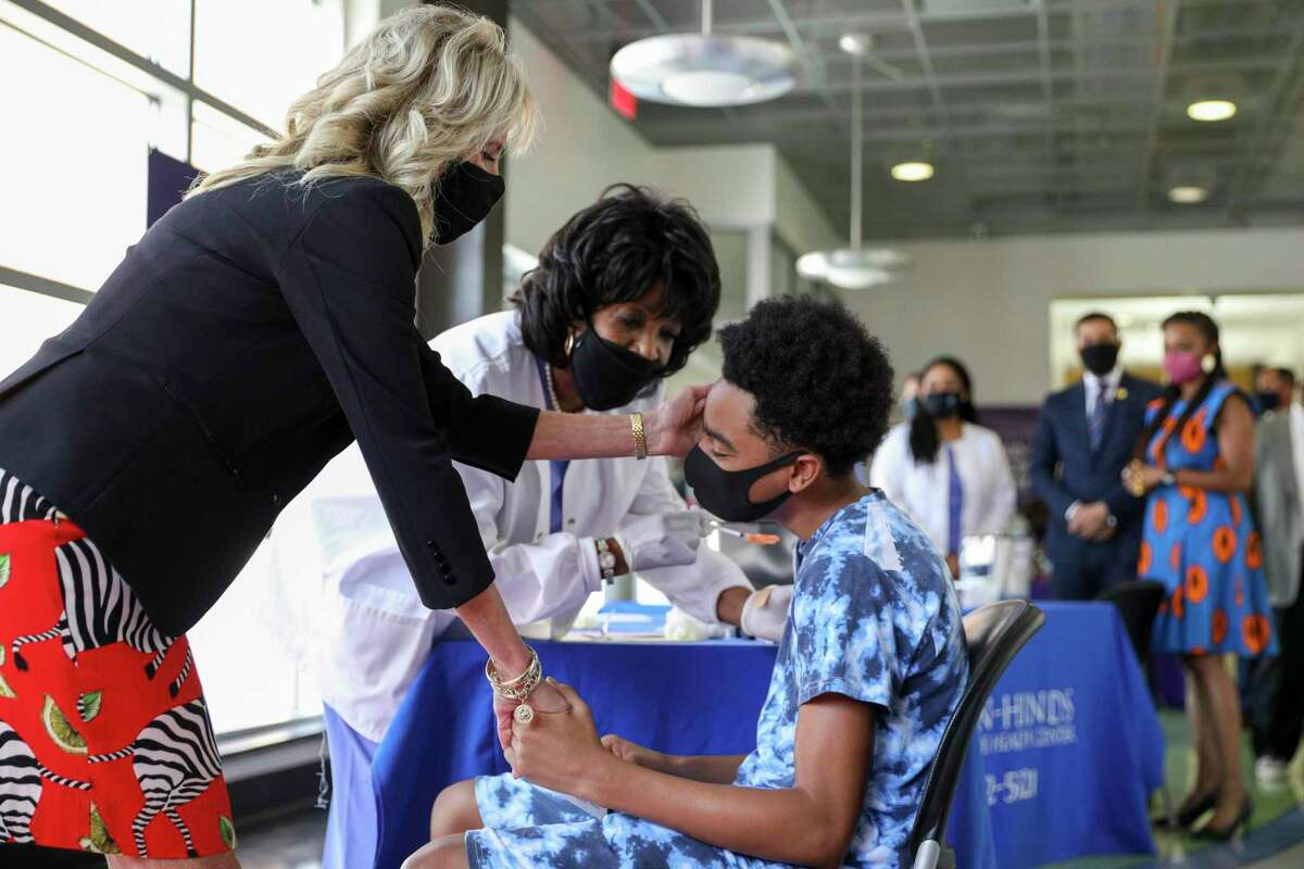 First lady Jill Biden comforts a person as they get a COVID-19 vaccination at a COVID-19 clinic at Jackson State University in Jackson, Miss., Tuesday, June 22, 2021. (Tom Brenner/Pool via AP)