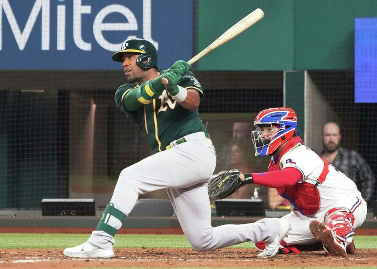 A's shortstop Elvis Andrus singles in the fifth inning against the Rangers. Andrews collected three hits and drove in two.