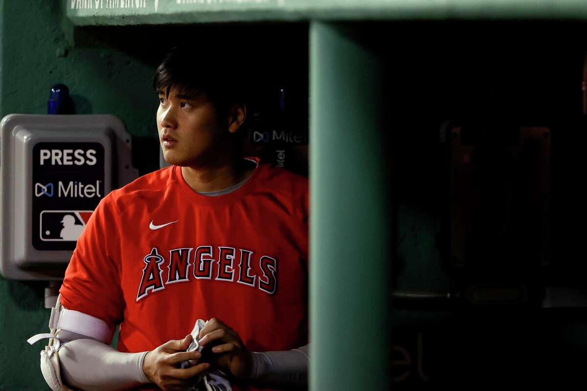 Los Angeles Angels' Shohei Ohtani in the dugout during the sixth inning of a baseball game against the Boston Red Sox Friday, May 14, 2021, at Fenway Park in Boston. (AP Photo/Winslow Townson)