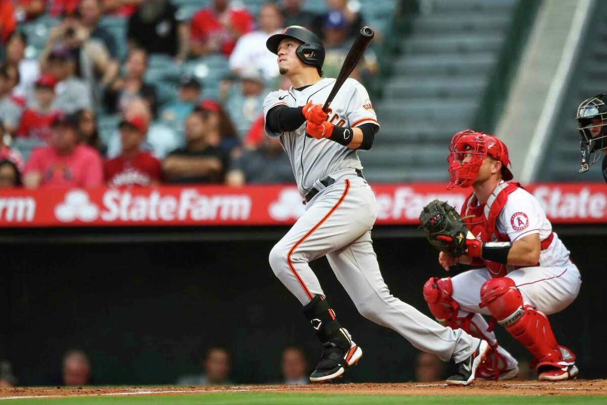 ANAHEIM, CALIFORNIA - JUNE 22: Wilmer Flores #41 of the San Francisco Giants hits a two-run home run in the first inning against the Los Angeles Angels at Angel Stadium of Anaheim on June 22, 2021 in Anaheim, California. (Photo by Meg Oliphant/Getty Images)