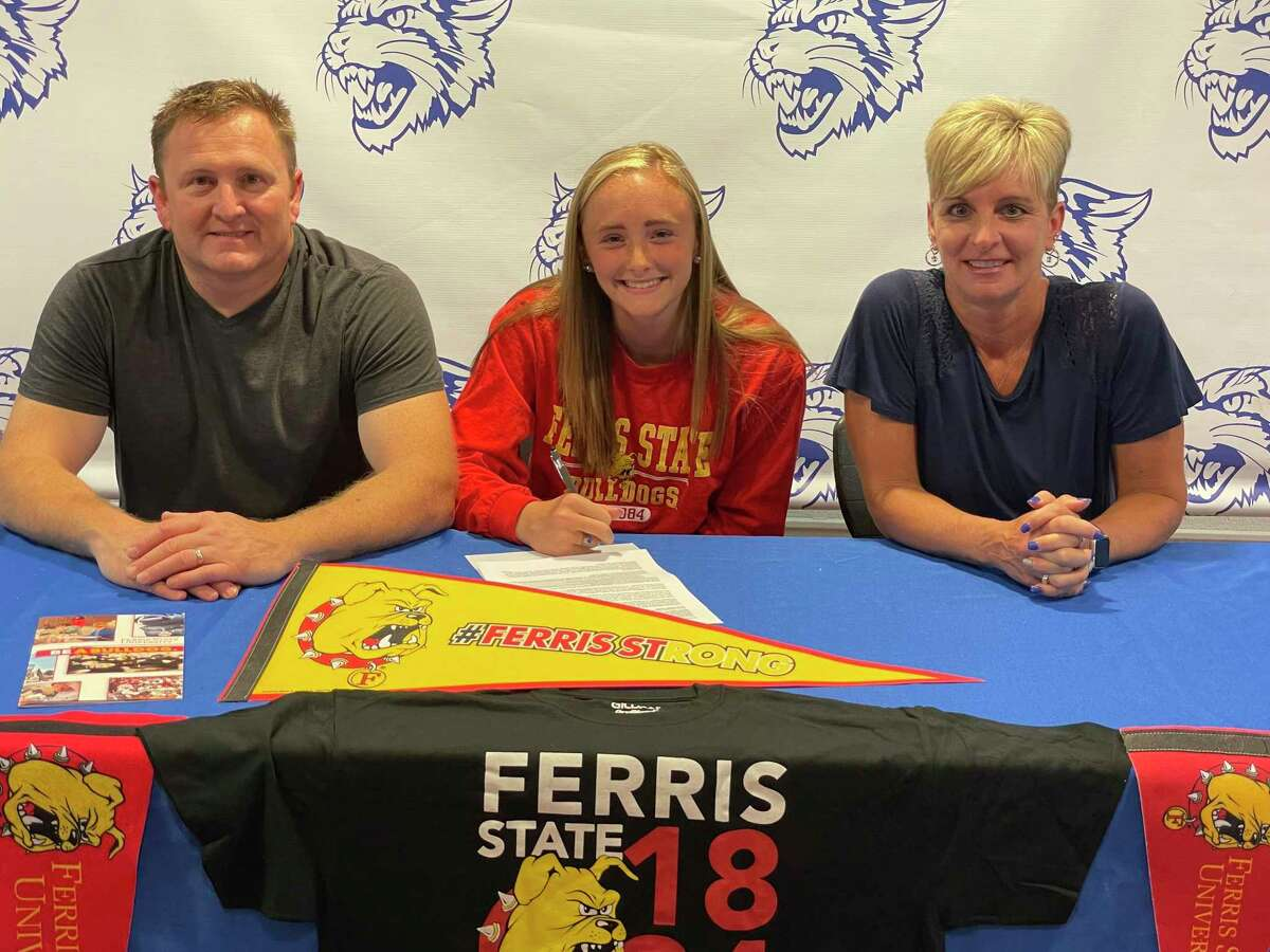 Mackenzi VanBuren (center) signed a letter of intent to run track and field at Ferris recently. He was joined by her parents, Brad and Michelle. (Courtesy photo)