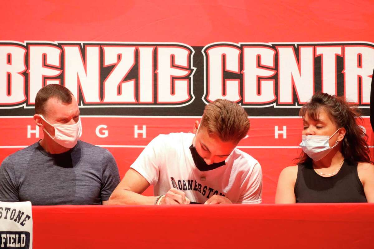 Seth Stoltz signs his letter of intent to run for Cornerstone University on May 19. (Robert Myers/Record Patriot)