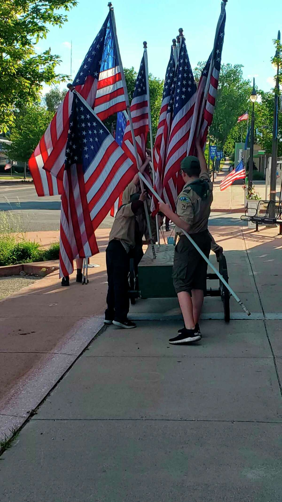 Scouts with BSA Troop 74 in Reed City gather the flags on display throughout town following a flag retirement ceremony on Flag Day, June 14. (Submitted photo)