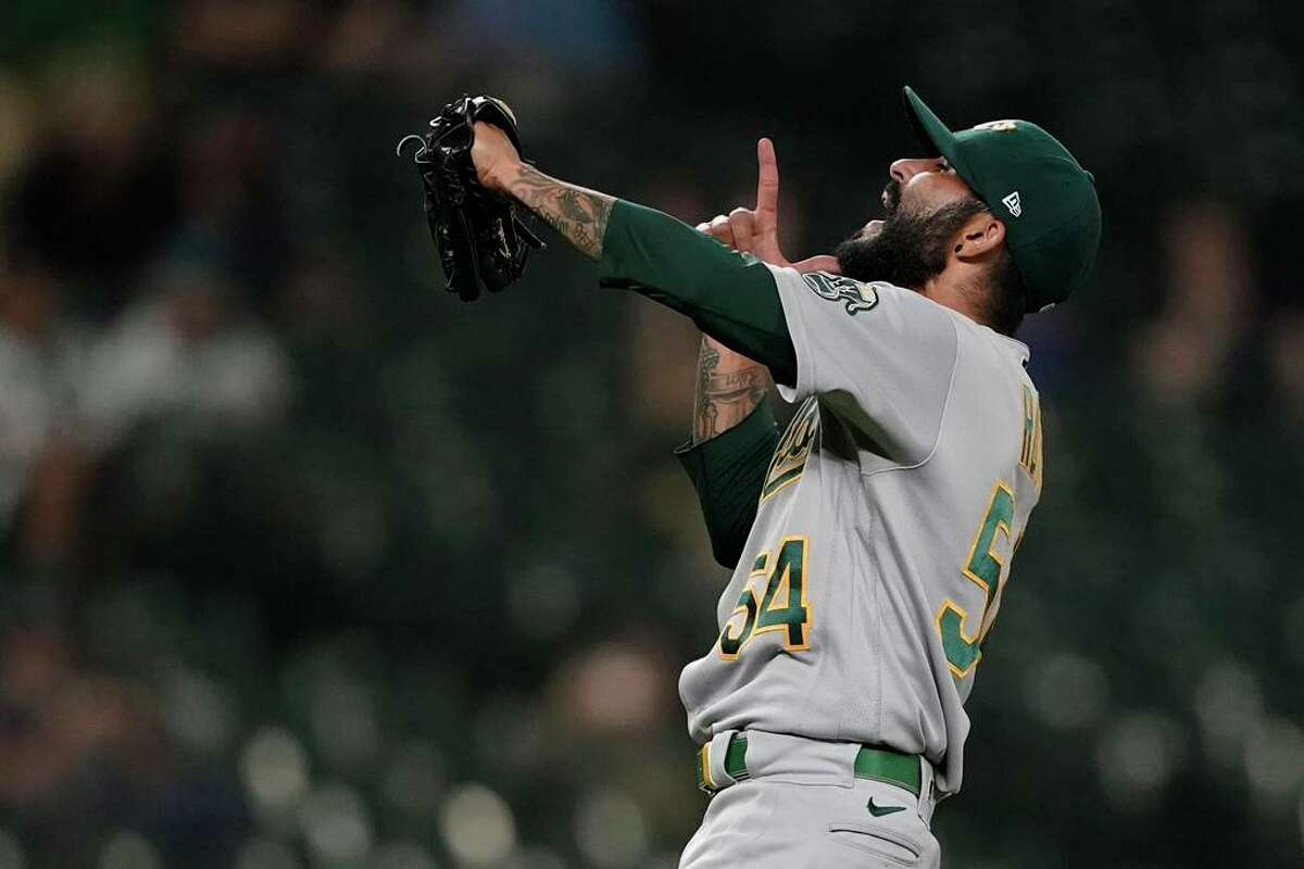 Oakland Athletics closing pitcher Sergio Romo reacts after the final out of the team's baseball game against the Seattle Mariners, Tuesday, June 1, 2021, in Seattle. The A's won 12-6. (AP Photo/Ted S. Warren)