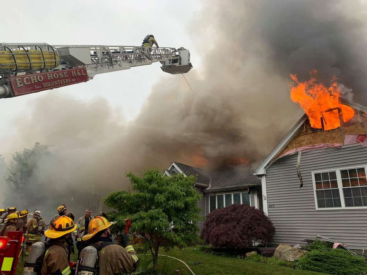 Firefighters battle a blaze at a Mica Court condo in Shelton, Conn., on Tuesday, June 22, 2021.