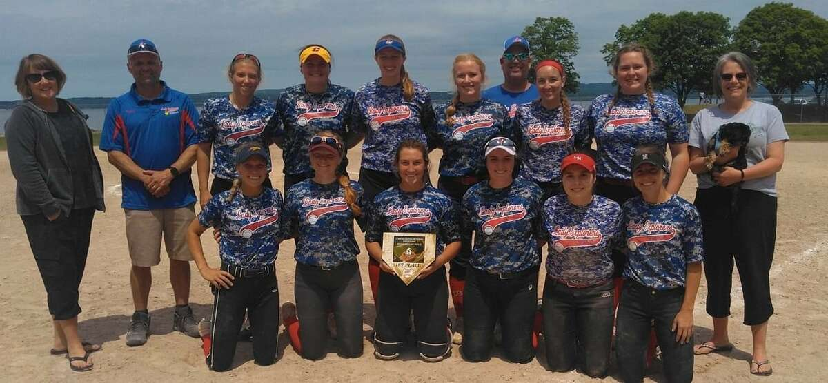 The Midland Lady Explorers 18-and-over softball team won the LeRoy Buchanan Memorial Tournament in Petoskey recently. Pictured are (back, from left) Rhonda Buchanan, daughter of LeRoy; Lady Explorers' manager Charles Keeley; Cam Coonan; Caitlyn Britton; Sara Andrasik; Faith Howe; assistant coach Mike Beyer; Maddie Burgess; Shelby Misiak; and Brenda Buchanan, daughter of LeRoy; and (front, from left) Lily Beyer, Skylar Coberly, Olivia Vitale, Katie Tobias, Anna Castelluccio, and Lauren Bobowski.