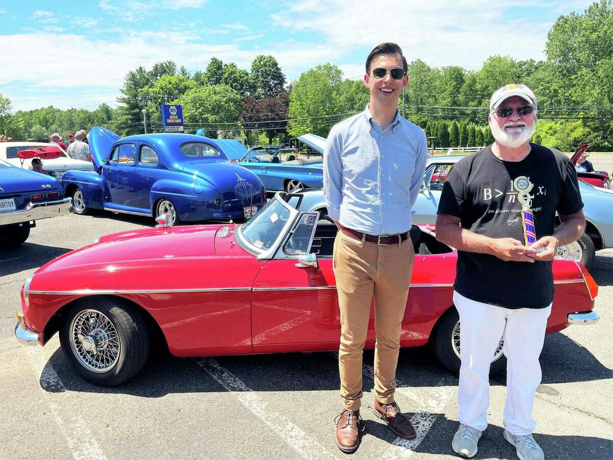 """From left, Middletown Mayor Ben Florsheim gave the Mayor's Choice award to George Gardner for his red 1970 MGB Sunday as part of the """"Start Your Engines to Sunday Funday - Middletown is Virtually Cruisin' 2021."""""""