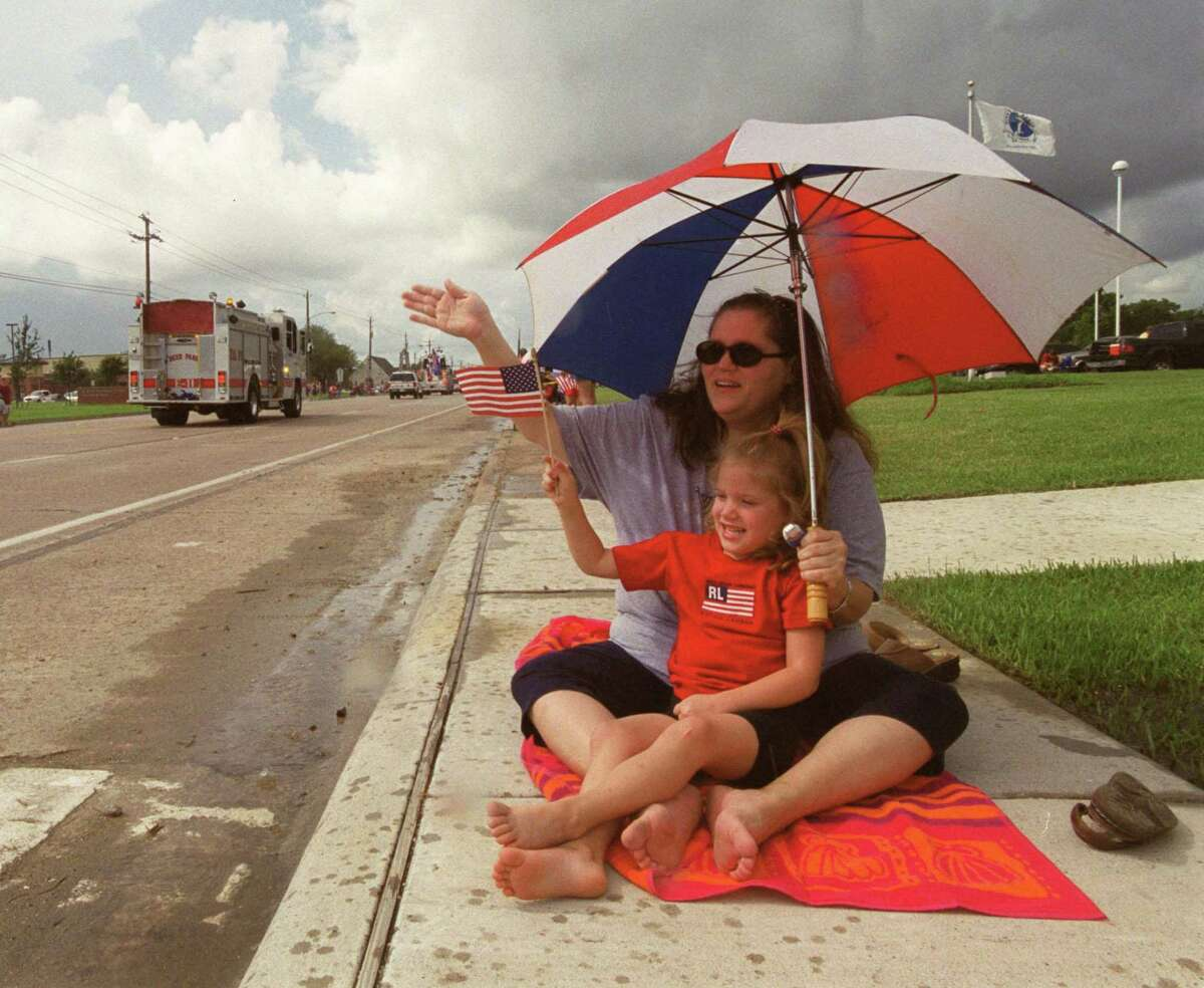 The city of La Porte's annual Fourth of July festivities, including parades, are a longstanding tradition. This parade from 2003 drew fans despite rainy weather.