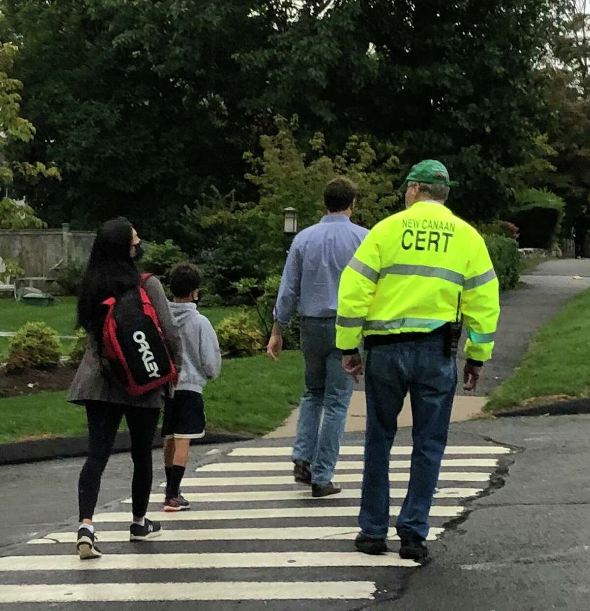 """New Canaan CERT Team member volunteer Kevin McIntosh escorts students across the street at this year's """"Walk to School Event."""" Continuing via virtual training this year, New Canaan's CERT is planning virtual, (online,) basic training classes, this summer, on Wednesdays, along with also Thursdays, on select dates."""