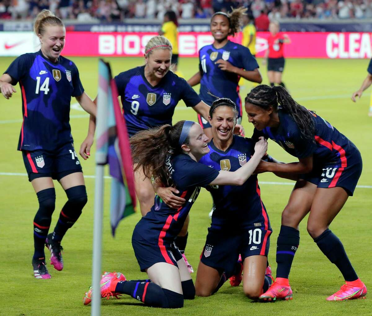 USA forward Carli Lloyd (10) is swarmed by her team mates after scoring a goal against Jamaica during the first half of their 2021 WNT Summer Series match Sunday, June 13, 2021, in Houston. (AP Photo/Michael Wyke)