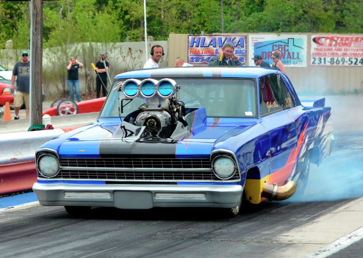 """Top Doorslammer racer Ron Brow of Belmont was the #1 qualifier at NMD's August event last season. He finished 6th overall in the 2020 standings with his Chevy II, called """"Blue Mamba."""" (Courtesy photo)"""