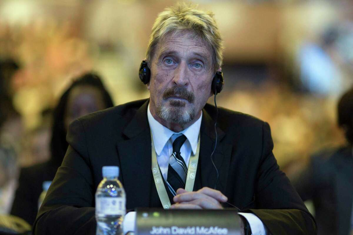 FILE - In this Tuesday, Aug. 16, 2016 file photo, founder of the first commercial anti-virus program that bore his name, John McAfee listens during the 4th China Internet Security Conference (ISC) in Beijing. Spain's National Court has approved the extradition of detained antivirus software entrepreneur John McAfee to the United States, where he is wanted on tax-related criminal charges that carry a prison sentence of up to 30 years.