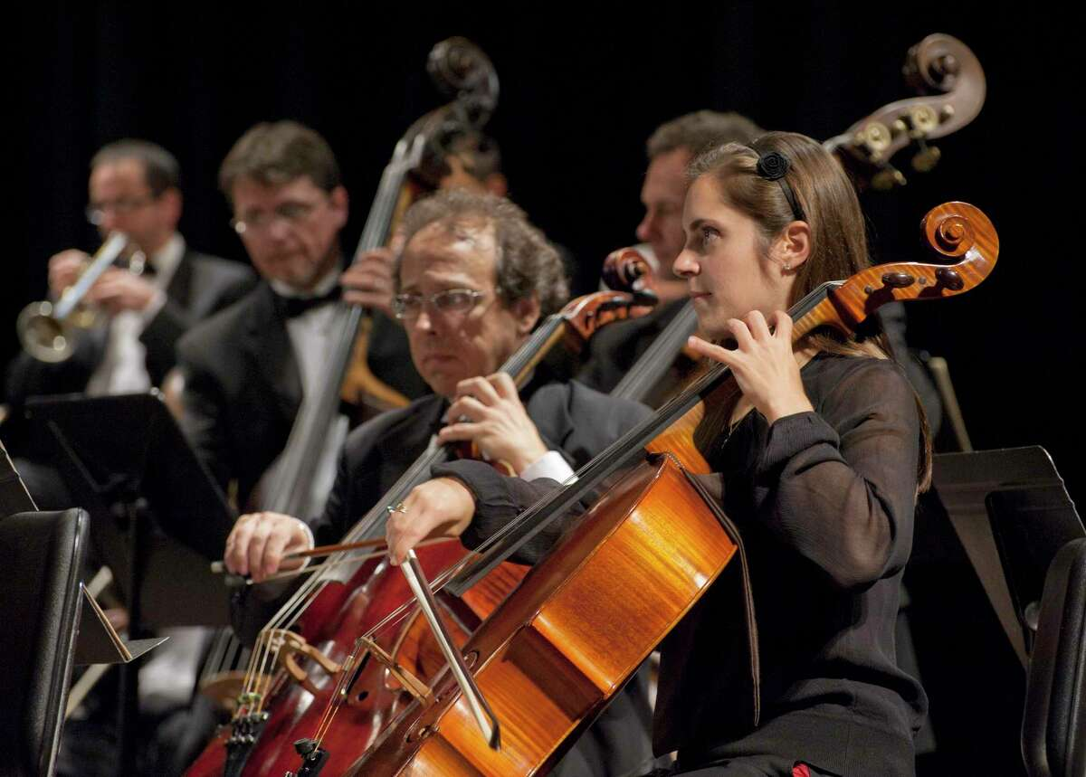 Ridgefield Symphony Orchestra string players perform in concert.