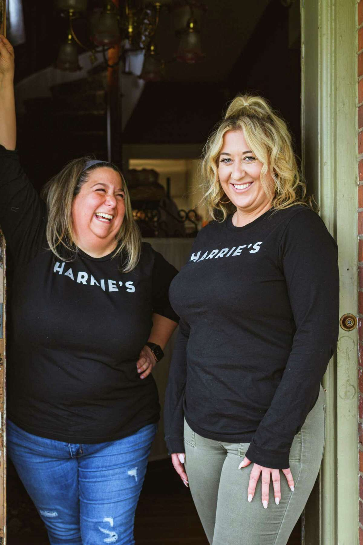 Carrie Carella, left, the founder and owner of NoRA Cupcake Company, and Heather Kelly. Carella and Kelly opened Harrie's Jailhouse together in late March.