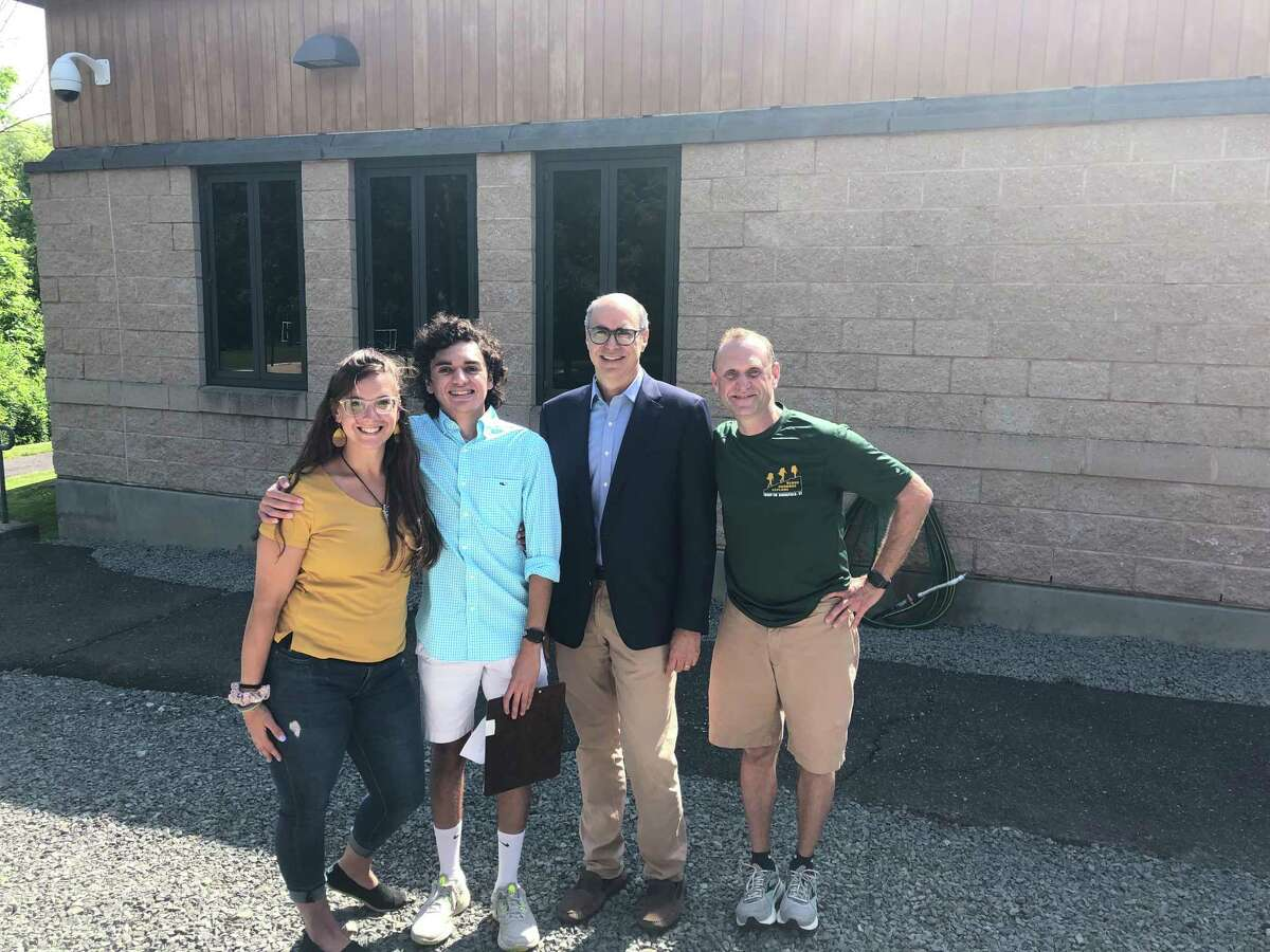 From left: ThinkFirst advocate Courtney Beckwith, Ridgefield Boy Scout Ben Rosenbaum, Boston Children's Hospital Neurosurgeon-in-Chief Dr. Mark Proctor and Ari Rosenbaum pose for a photo at Ben's Eagle Scout presentation, which raised awareness about traumatic brain injury and prevention.