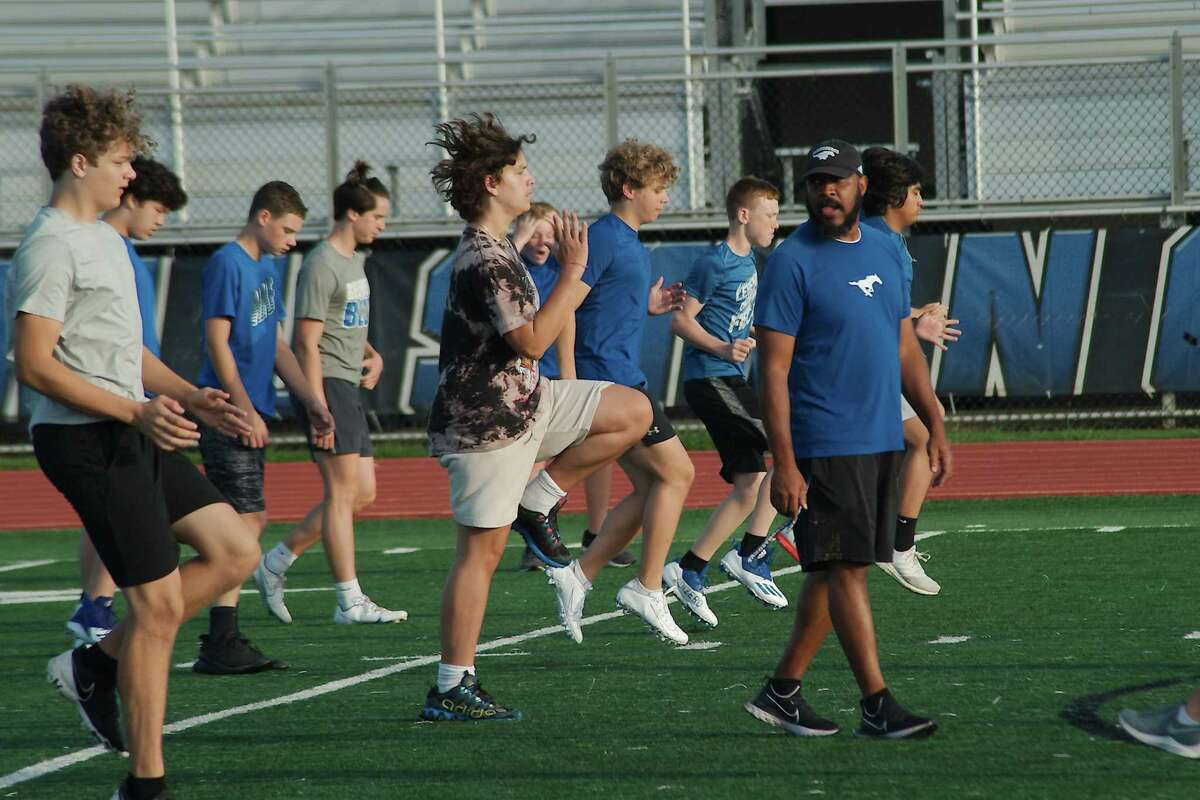 Friendswood assistant football coach Bruce Bolden supervises a conditioning drill at the Friendswood summer strength and conditioning camp Wednesday at Friendswood High School.