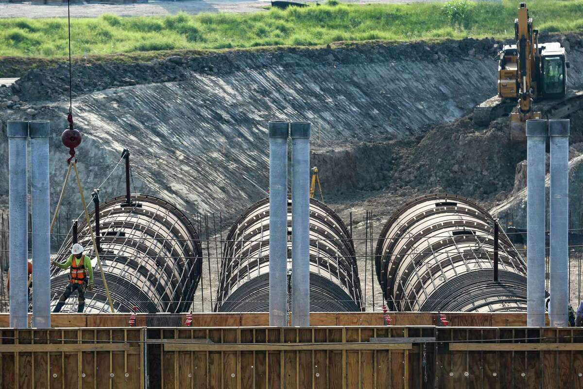 Construction crews work on the new outlet works at Barker Reservoir Thursday July 26, 2018 in Houston. The three conduits will soon be the new channel for water to be released from the dam. (Michael Ciaglo / Houston Chronicle)