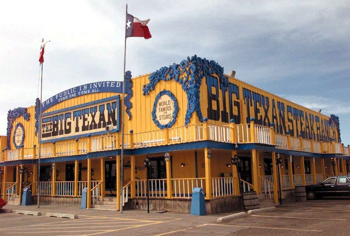 The Texas flag flies in the West Texas wind over the Big Texan Steak House in Amarillo. The restaurant dares travelers to finish a 72-ounce sirloin in an hour and get it free.