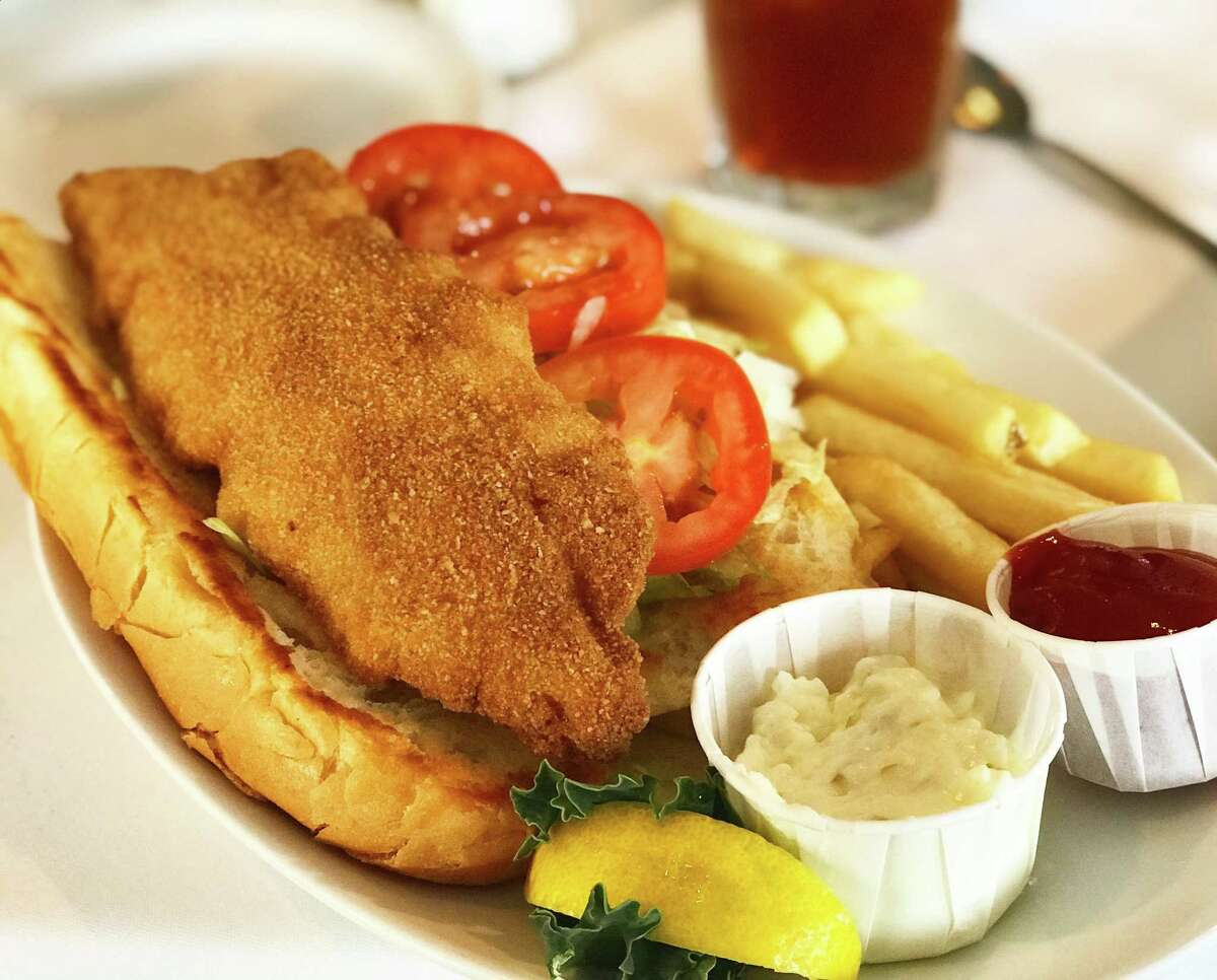 The 1917 Famous Fish Sandwich, a po'boy made with fried or blackened fish at the iconic Christie's Seafood & Steaks.