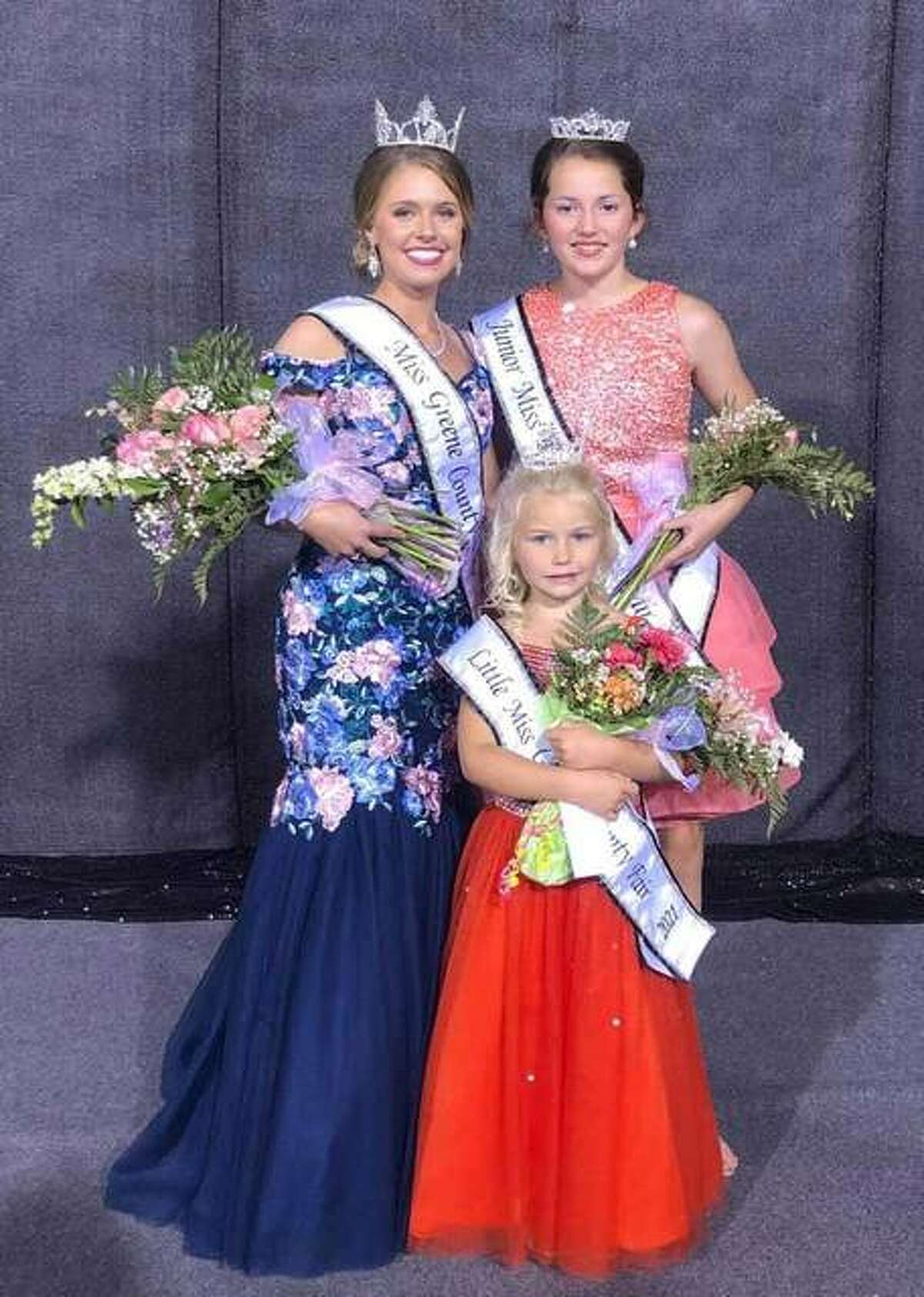 Lydia Lansaw, left, was crowned Miss Greene County Tuesday night at the Greene County Fair in Carrollton. Leah Wood, right, was crowned Junior Miss Greene County and Brooke Thornton, center, was crowned Little Miss Greene County. The area's first fair of the year continues through Saturday.