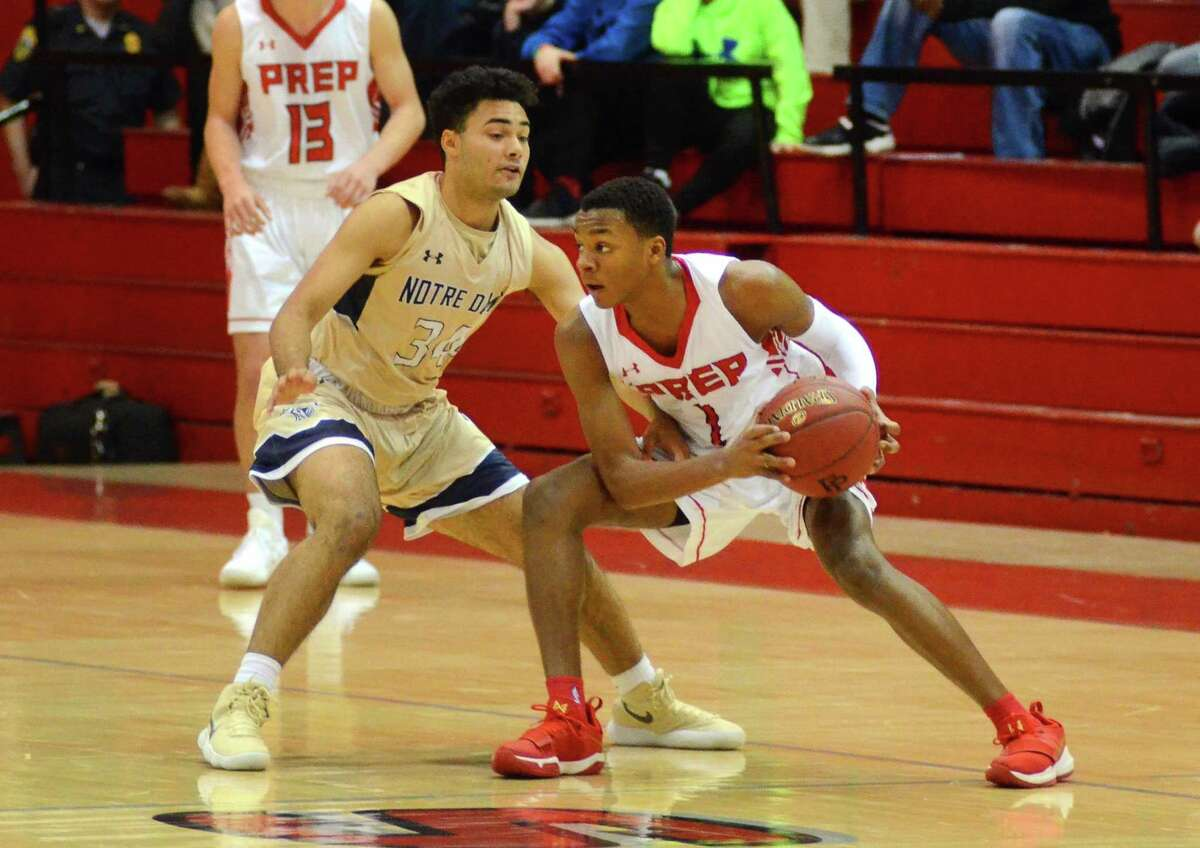 Fairfield Prep's Avery Brown looks to pass the ball as Notre Dame-Fairfield's Philip Conner defends during the Fairfield Prep Holiday Classic in 2017.