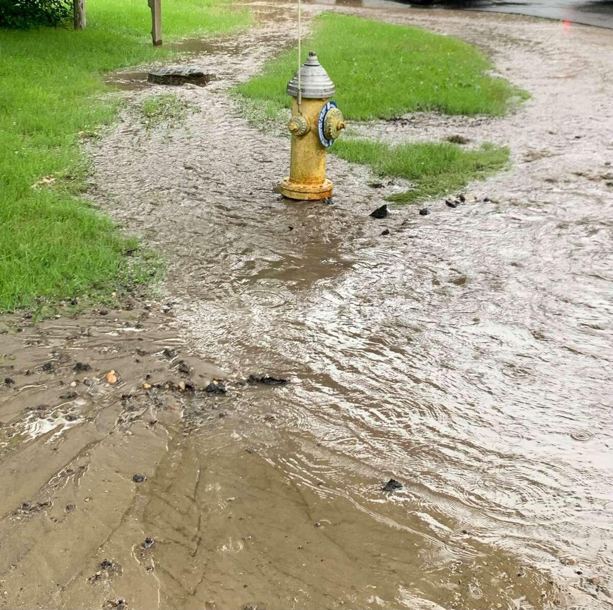 A water main break in Monroe, Conn., on Tuesday, June 22, 2021.