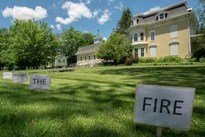 Signs reading 'fire the board because transparency is not illegal' line Bridge St. on the lawn of Schoharie Free Library on Wednesday, June 23, 2021 in Schoharie, N.Y. (Lori Van Buren/Times Union)