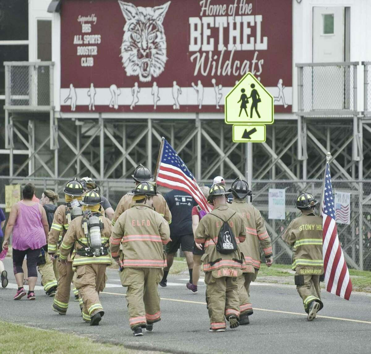 Firefighters walk the route of the Bethel's Tunnel to Towers 5K in 2018.
