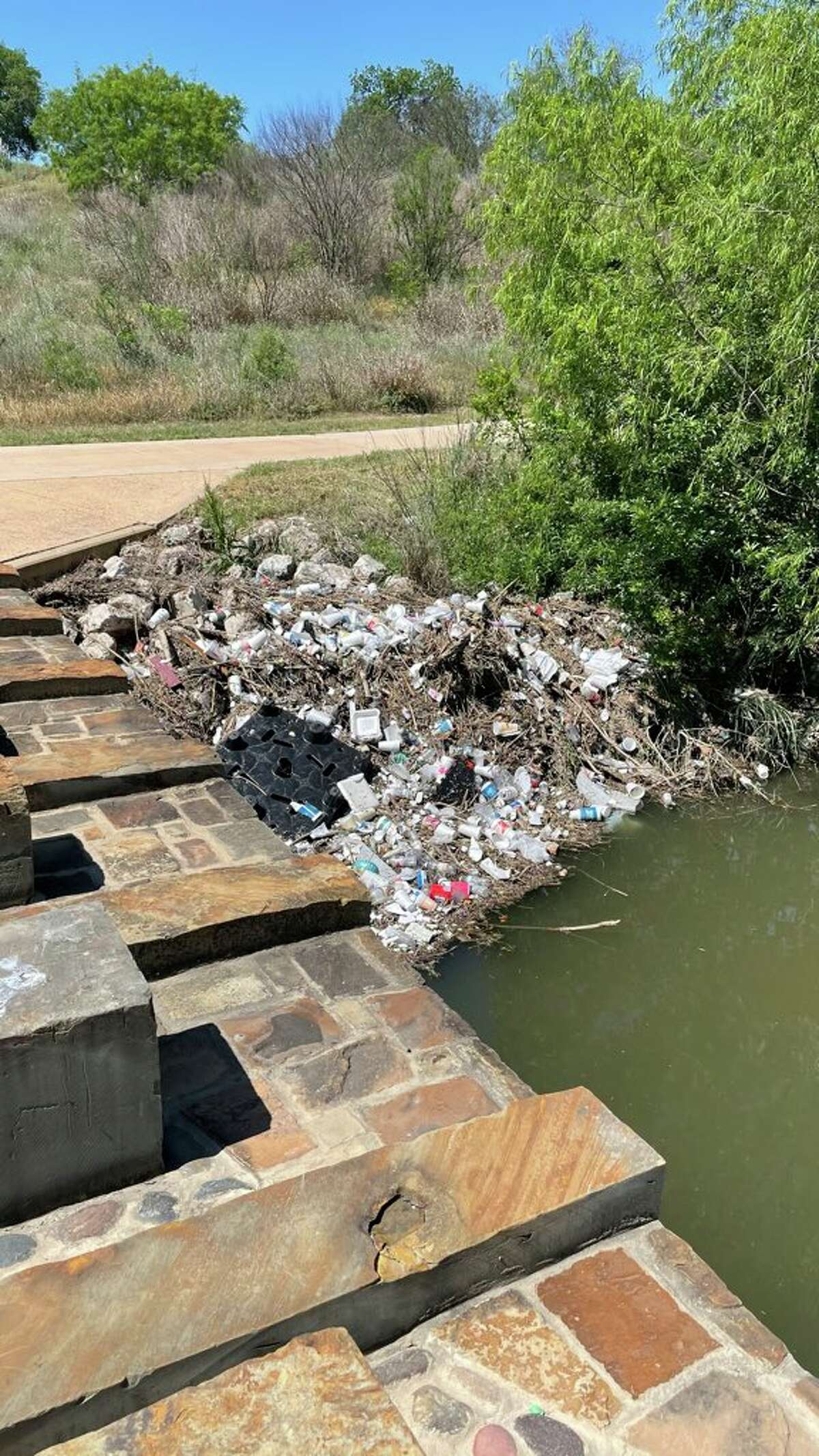 In April, a pile of trash was found on the San Antonio River, south of downtown.