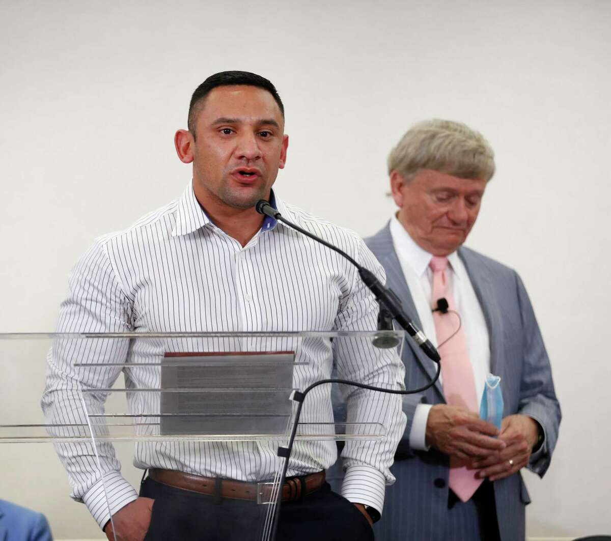 Then Houston Police officer Felipe Gallegos speaks as attorney Rusty Hardin listens during a press conference at Hilton Americas, in Houston, Tuesday, Jan. 26, 2021.