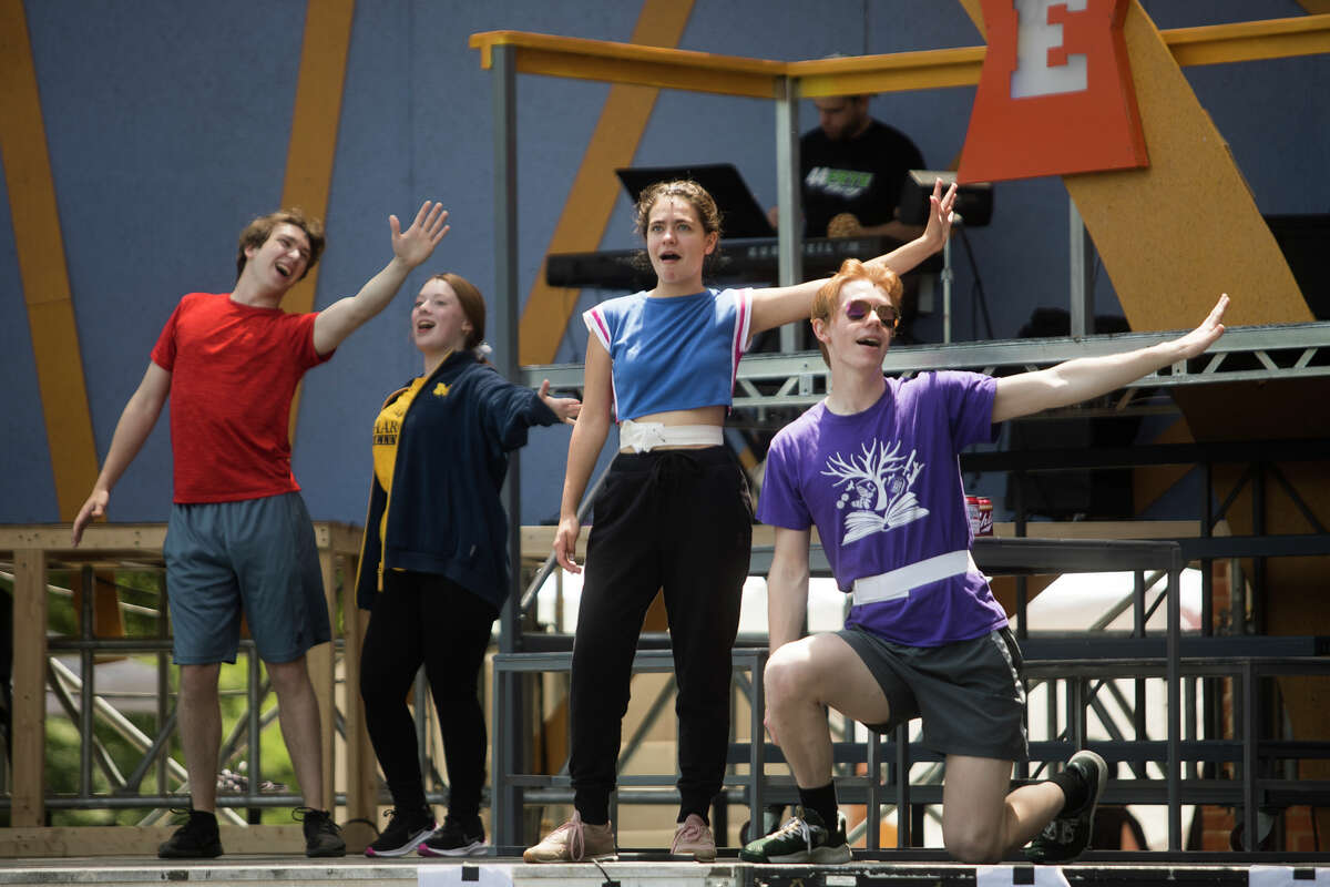 """From left, Stanley Misevich in the role of Kenickie, Anastasia Breen in the role of Marty, Emma Massey in the role of Betty Rizzo and Josh Moore in the role of Danny Zuko perform a musical number during a rehearsal for the Midland Center for the Arts' production of """"Grease"""" Wednesday, June 23, 2021 in Midland. The show will run Friday, June 25 through Sunday, June 27. (Katy Kildee/kkildee@mdn.net)"""