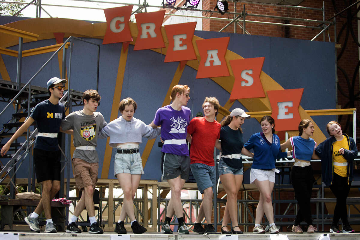 """Cast members perform a musical number during a rehearsal for the Midland Center for the Arts' production of """"Grease"""" Wednesday, June 23, 2021 in Midland. The show will run Friday, June 25 through Sunday, June 27. (Katy Kildee/kkildee@mdn.net)"""