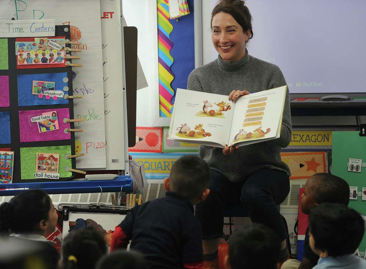 """Children's author and illustrator Madeline Valentine, of Queens, NY, reads her book """"I Want That Nut"""" to a pre-k class during the 33rd Annual Read Aloud Day at Bryant School in Bridgeport, Conn. on Thursday, October 18, 2018. Over six hundred volunteer readers spread out to read to to every pre-kindergarten to sixth grade class in the Bridgeport Public Schools."""